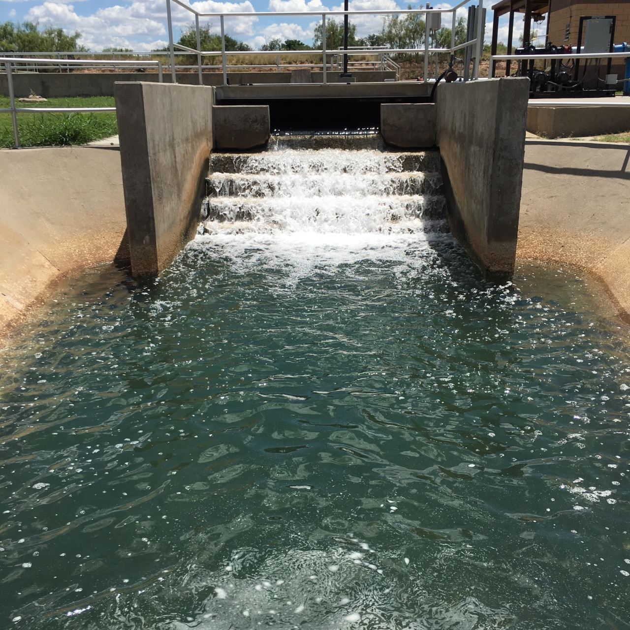 A picture of water cascading from the final effluent at the cascade